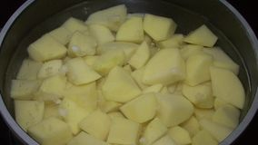 Potatoes in a pot stock video
