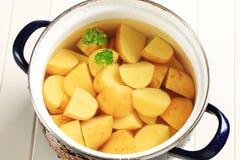 Potatoes in a pot Stock Photos