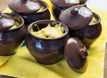 Potatoes in pots with cheese delicious royalty free stock photo
