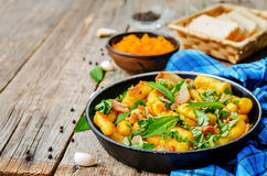 Potatoes pumpkin gnocchi with bacon, cilantro and mint Stock Image