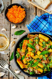Potatoes pumpkin gnocchi with bacon, cilantro and mint Stock Images