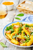 Potatoes pumpkin gnocchi with bacon, cilantro and mint Stock Photography