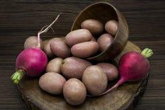 Potatoes and radishes Stock Photo