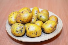 Potatoes raw vegetables food in plate Stock Image