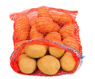 Potatoes in red bag Stock Photo