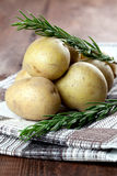 Potatoes and rosemary Royalty Free Stock Image