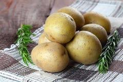 Potatoes and rosemary Royalty Free Stock Photo