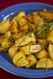 Potatoes with rosemary. On blue plate Stock Photo