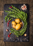 Potatoes with rosemary, garlic and spices, raw ingredients Stock Photo