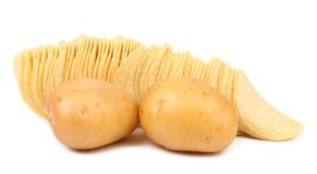 Potatoes and row of chips. Royalty Free Stock Photography