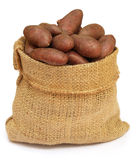 Potatoes in a sack bag over white background. Some red potatoes in a sack bag over white background stock photo