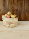 Potatoes in a sack Stock Images