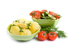 Potatoes and salad Stock Photos