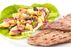 Potatoes salad with grilled meat Royalty Free Stock Photo