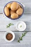 Potatoes salt and cumin Royalty Free Stock Images