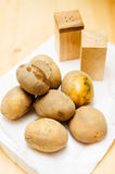 Potatoes, salt and pepper Royalty Free Stock Photography