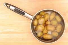 Potatoes in a saucepan Royalty Free Stock Photos