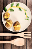 Potatoes are served on dish with basil sauce and fennel Royalty Free Stock Photo