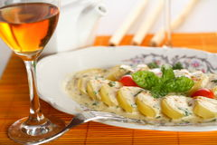 Potatoes served with wine Stock Image