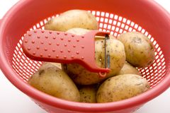 Potatoes with sieve Stock Photography
