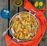 Potatoes skillet with pumpkin and herbs Royalty Free Stock Images