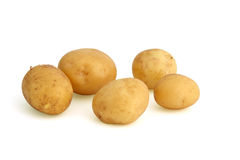 Potatoes with skin. Fresh potatoes with skin, isolated on white background Royalty Free Stock Image