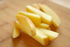 Potatoes are sliced julienne Royalty Free Stock Photos