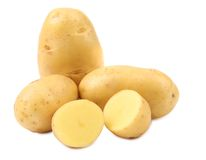 Potatoes and splited tuber. Royalty Free Stock Photo