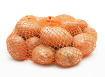 Potatoes in string-bag Stock Image