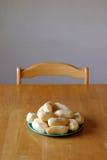 Potatoes table. Peeled potatoes sitting on dinner table Stock Photo