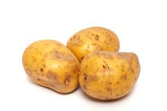 Potatoes. Three potatoes on a white background. Horizontal position royalty free stock image