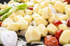 Potatoes tomatoes onion and peppers parties Stock Images