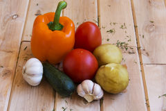 Potatoes, tomatoes, peppers, cucumbers and garlic on a wooden su Stock Photo