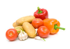 Potatoes, tomatoes, peppers and garlic on a white background clo Royalty Free Stock Photography