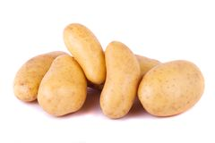Potatoes on white. Close up view of some potatoes isolated on a white background stock photo