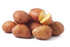 Potatoes on white background. Heap of potatoes isolated on white background Stock Image