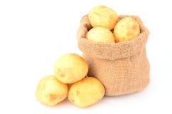 Potatoes. On a white background Stock Photos