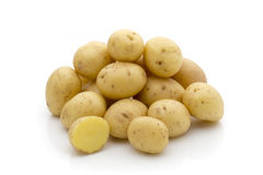 Potatoes on the white background.  New harvest. Stock Photo