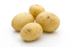 Potatoes on the white background.  New harvest. Royalty Free Stock Image