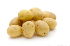 Potatoes on the white background.  New harvest. Royalty Free Stock Photo