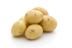 Potatoes on the white background.  New harvest. Royalty Free Stock Images