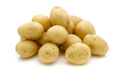 Potatoes on the white background.  New harvest. Royalty Free Stock Photos