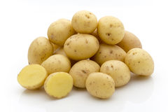 Potatoes on the white background.  New harvest. Stock Image