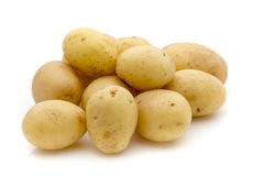 Potatoes on the white background.  New harvest. Stock Photography