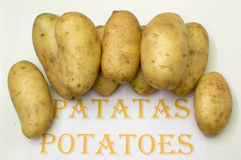 Potatoes. On white background,  in Spanish and English Royalty Free Stock Photos