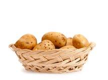 Potatoes in a wicker basket Stock Photo