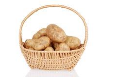 Potatoes in wicker basket Royalty Free Stock Photos
