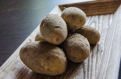 Potatoes on wood tray Royalty Free Stock Images