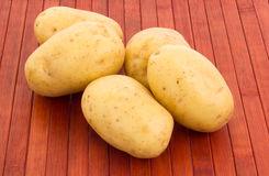 Potatoes on wooded background. Some potatoes on wooded background Royalty Free Stock Image