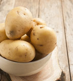 Potatoes on wooden backgrond Royalty Free Stock Photography
